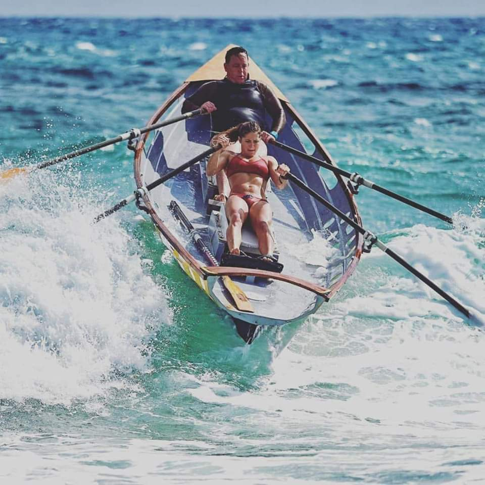 Two in a surf row boat