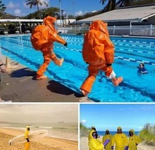 Swimmers with orange suits