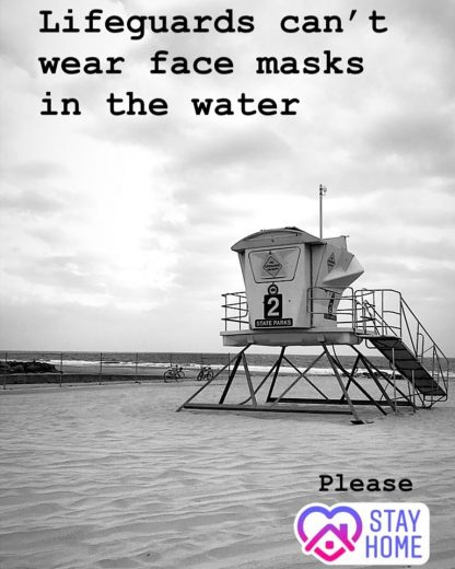 Please stay home as lifeguards can't wear masks in the water with image of beach tower.